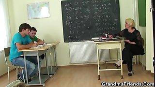 Granny teacher double penetration in the classroom