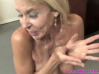 Busty granny cumblasted by happy young dude