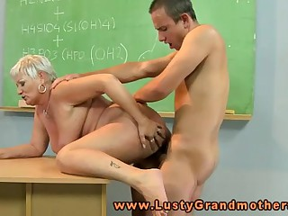 Amateur granny teacher drooling on young cock