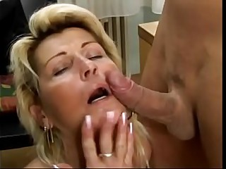Hot blonde granny takes young cock in her hairy twat