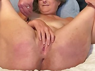 Beautiful Mature Milf Enjoys Fingering Her Wet Cunt With Her Legs Wide Open mature milf granny