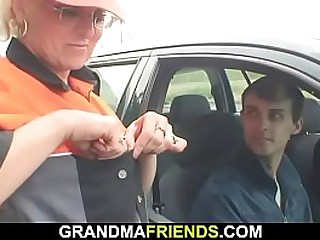 Shaved granny is fucked in the fields