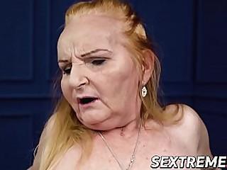 Redhead granny rides cock like pro