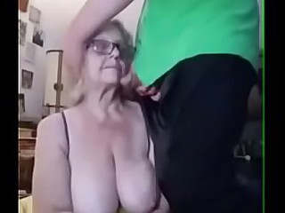 Granny with big boobs takes younger cock