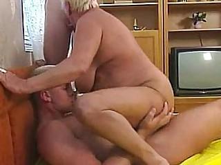 Busty blonde granny enjoys threesome fucking