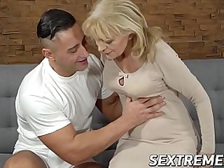 Young man drilling a horny cute granny