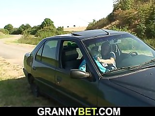 Young guy fucks old granny outdoors