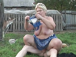 A granny has a craving for young cock in her farm and she gives a good blowjob