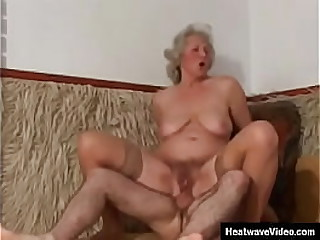 Fuckin At 50 #13 - Kiss Maria - This granny still has some damn fine titties for her age, and she also shows off her long legs in stockings