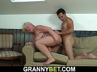 Busty granny please him with hot blowjob