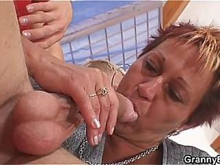 Granny rides neighbour's cock