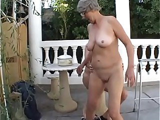 Slutty granny Margo loves sucking on a old cock outdoors then fuck with young guy