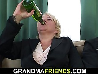 Busty blonde granny gets double dicked