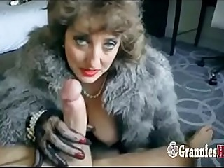 Classy Granny Brunette Loves To Suck Big Young Cock