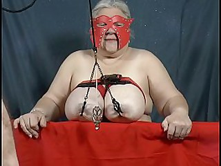 Granny has her heavy tits lifted by her nipples (tit t.)