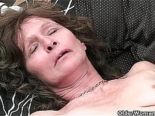 Saggy granny in stockings masturbates hairy pussy