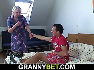 Busty granny gets doggy-fucked by horny young dude