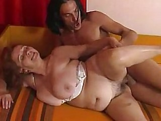 Granny prepares her pussy with a dildo before fucking