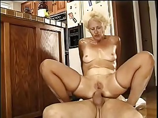 Granny blonde whore gets her twat and asshole drilled by two waiter's dicks